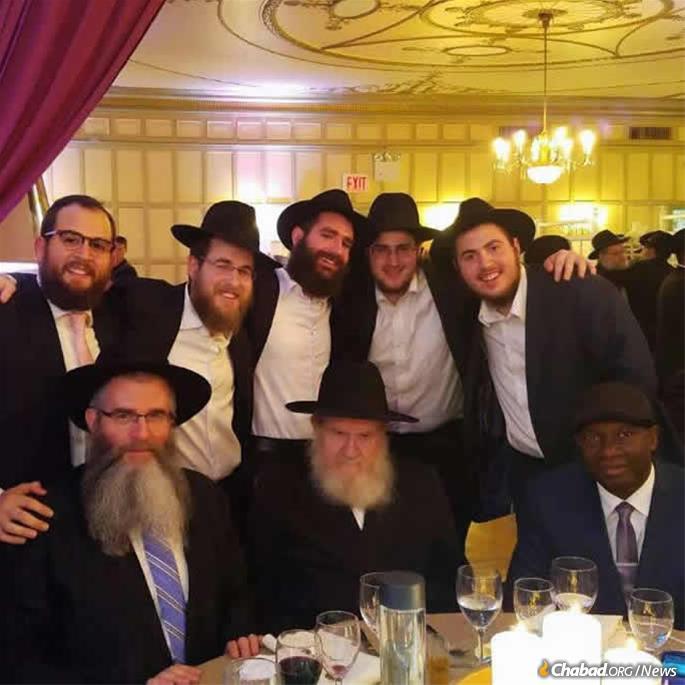 At a Gordon family celebration are, front row, from left: Rabbi Yossy Gordon, Rabbi Yisroel Gordon and Gabriel Pierre