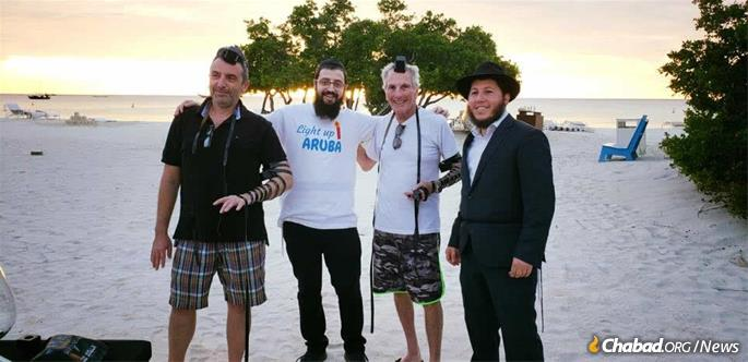 Wrapping tefillin on the beach