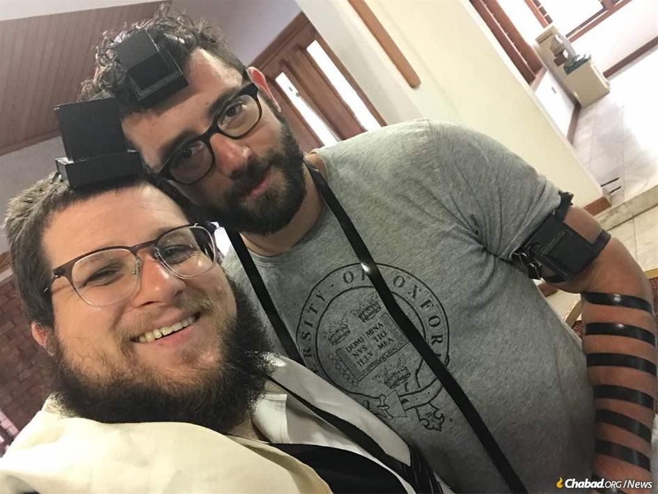 Zachary Bucheister, right, describes what it's like to be part of Ghana's tight-knit, but chronically transient Jewish community, anchored by Rabbi Noach Majesky.