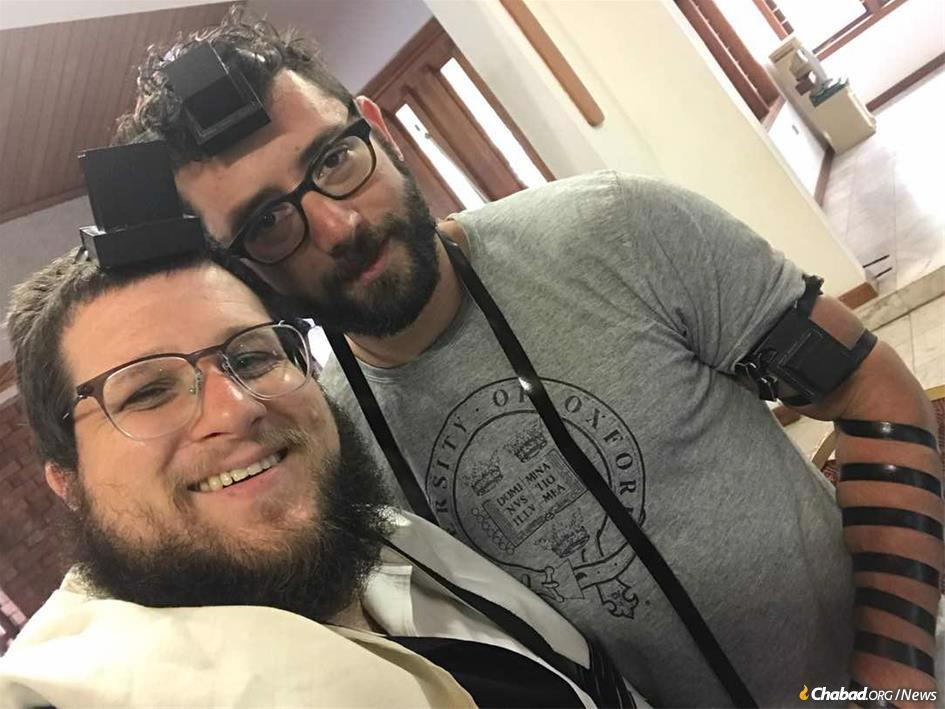 Zachary Bucheister, right, describes what it's like to be part of Ghana's tight-knit but chronically transient Jewish community, anchored by Rabbi Noach Majesky.