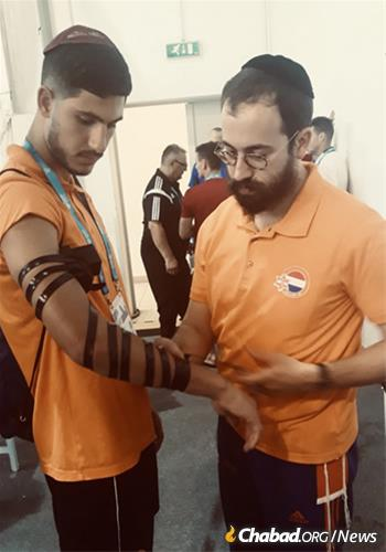 Jacobs said he spent time as a supportive spectator, viewing the matches in between tefillin-wrapping and Jewish conversations, deepening connection with athletes from his home country and engaging with others from France, Argentina, Gibraltar, Germany, the United States and other countries.