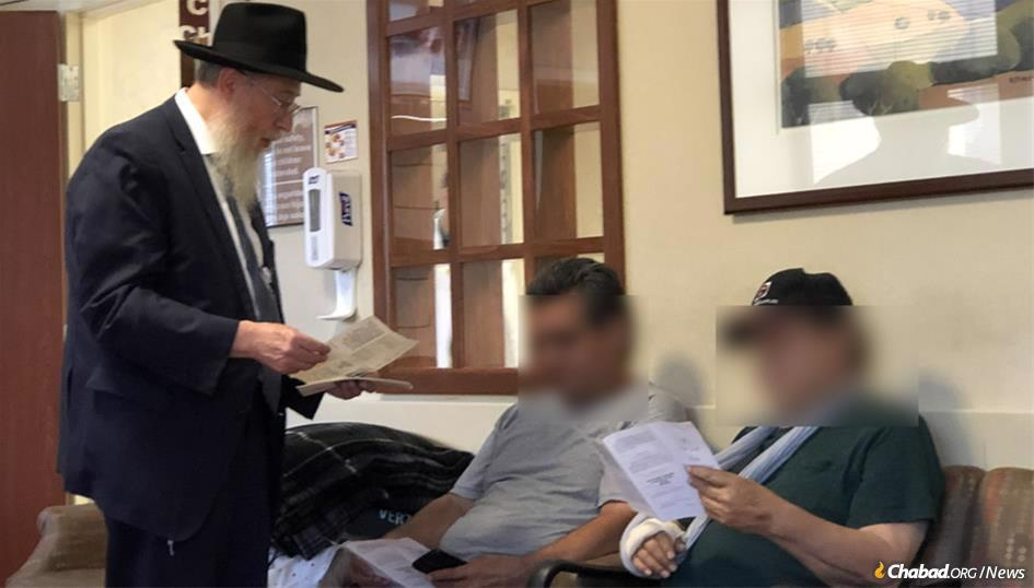 Rabbi Yisroel Greenberg, director of Chabad of El Paso, Texas, shared pamphlets containing prayers for healing with those being treated for injuries and those who lost loved ones after an Aug. 3 mass shooting.
