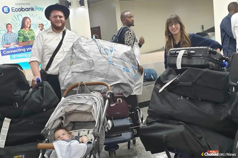 Rabbi Chaim and Dina Bar Sella arrive in Rwanda with their 8-month-old son, Shneur Zalman, to open a new Chabad center in Kigali that will include the nation's first synagogue, where Bar Sella will be the country's first permanent rabbi.