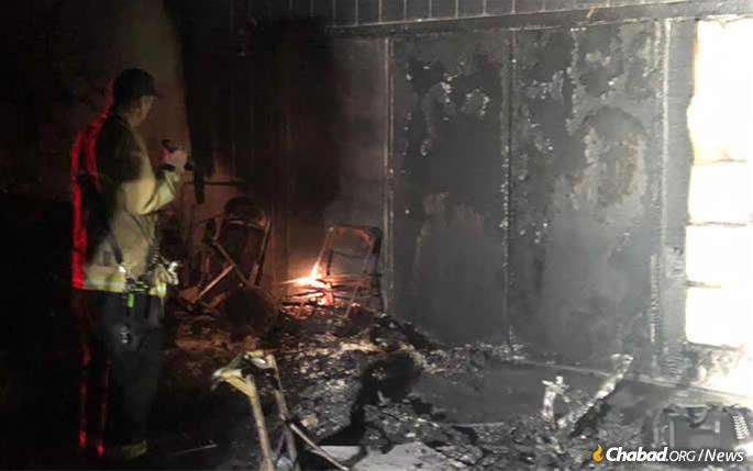 The Torah scrolls were spared from the fire.