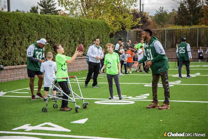 Playing on the NFL/New York Jets-sponsored flag-football field at LifeTown. (Photo: Mendel Grossbaum)