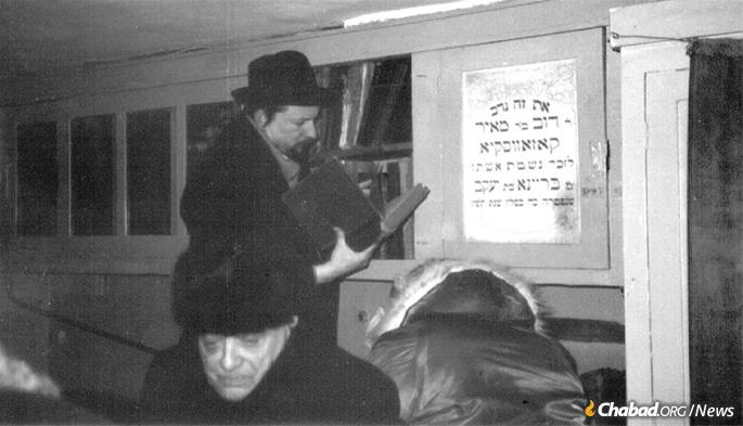 Rabbi Sholom Ber Levine, chief librarian of the Library of Agudas Chasidei Chabad, was one of four men sent to Moscow by the Rebbe to identify and retrieve the Lubavitch library held by the Soviet state. Here, he searches through books in the synagogue in Dnepropetrovsk.