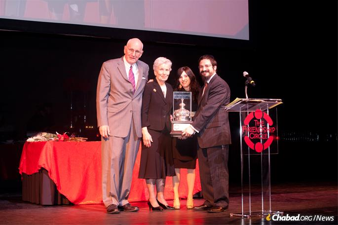 Philanthropists Jerry and Paula Gottesman were honored at a Friendship Circle dinner in 2011 by Rabbi Zalman amd Toba Grossbaum.