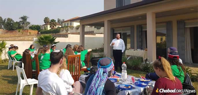The rabbi speaks to Jewish youth touring Rwanda.
