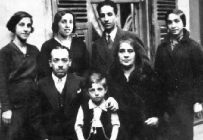 My grandfather, Isaac, (back row, second to right) with his sisters Stella, Lucha, and Sarina. Front row: His parents and younger brother Dario who survived and lives in Israel.