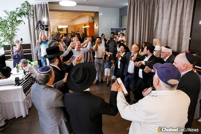 Celebrating inside the hotel venue, where a ceremony finalizing the letters in the Torah scroll was held.