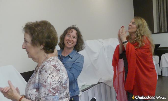 Women celebrate the bar mitzvah.