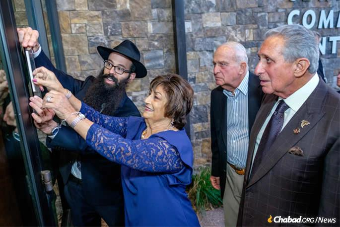 Affixing the mezuzah were Carmen Blank, Rabbi Dovie Shapiro, Michael Blank and Arthur Blank.