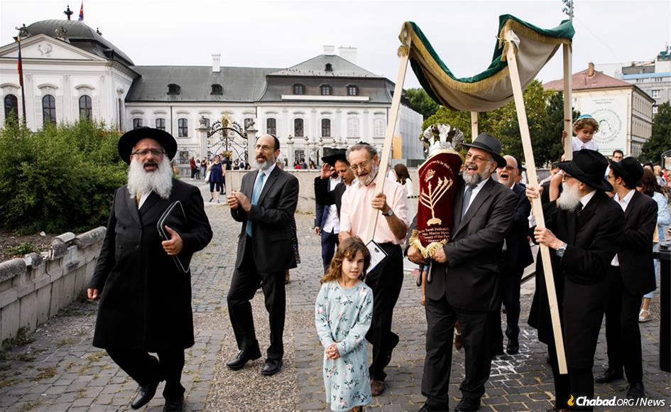 The first new Torah scroll to have been written in Slovakia since the Jewish community was decimated by the Nazis during the Holocaust is greeted by a celebratory procession through the capital city of Bratislava and past the Presidential Palace to a new Chabad center established in 2017.