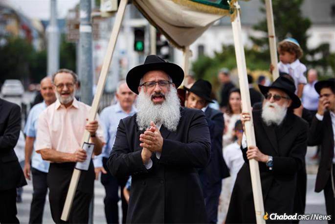 Rabbi Baruch Myers, center, and his wife, Chanie, have helped rebuild the once-thriving pre-Holocaust Jewish community of Bratislava and Slovakia.