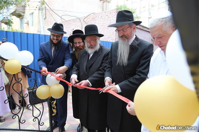 The ceremonial ribbon-cutting.