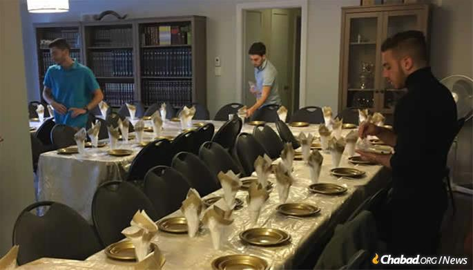 Chabad Houses around the world are readying for services and setting their tables, like this one is Guelph, Ontario, to share a festive meal with local residents and travelers on the holiday.