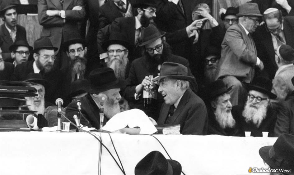 Herman Wouk drew deeply from his intense, decades-long relationship with the Rebbe, Rabbi Menachem M. Schneerson, of righteous memory, shown together here at a Chassidic gathering in 1972. (Photo: JEM)