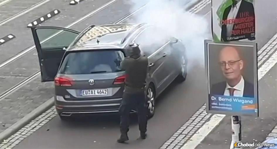 A security camera captures a gunman opening fire outside of a synagogue during Yom Kippur services in Halle, Germany.