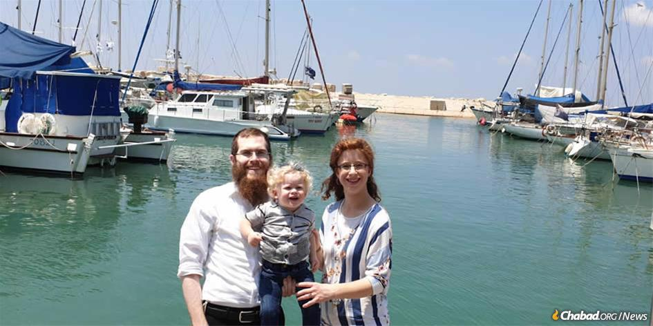 Rabbi Yona Elimelech and Esther Malka Zilbershtrom with their baby son, Menachem Mendel, at the Tiberias marina.