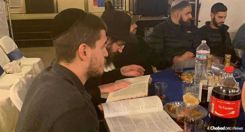 Inon Cohen, left, joins Rabbi Dovber Berkowitz, second from left, at the completion of a two-year study of the Talmud Tractate Berachot in honor of Cohen's father.
