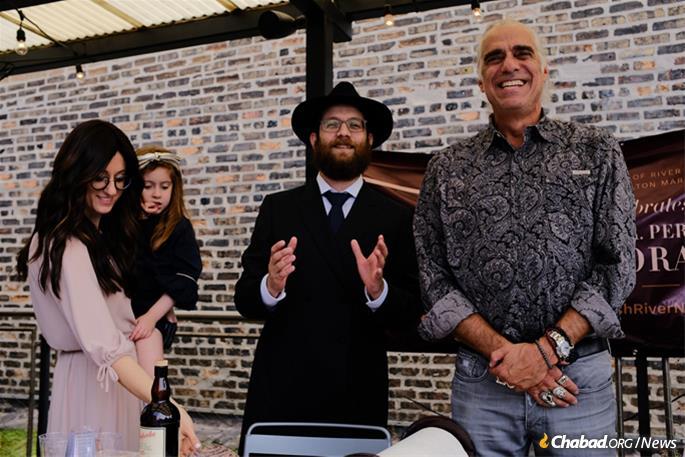 Chava and Rabbi Avraham Kagan with designer James Geier.