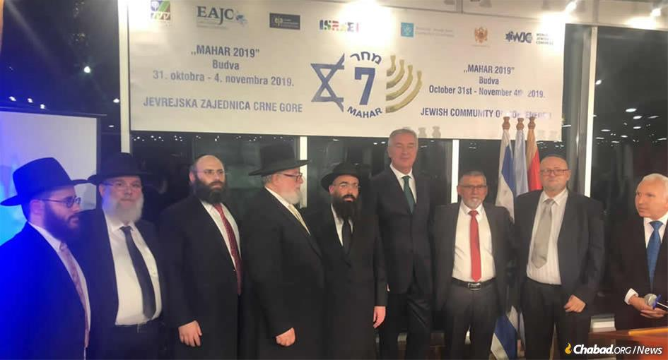 President Milo Djukanovic of Montenegro, center, flanked by rabbinic and community leaders at the Mahar Conference where Rabbi Ari Edelkopf, center, was formally appointed chief rabbi of Montenegro.