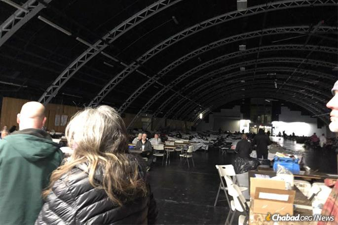 Cavernous shelters are housing tens of thousands of evacuees.