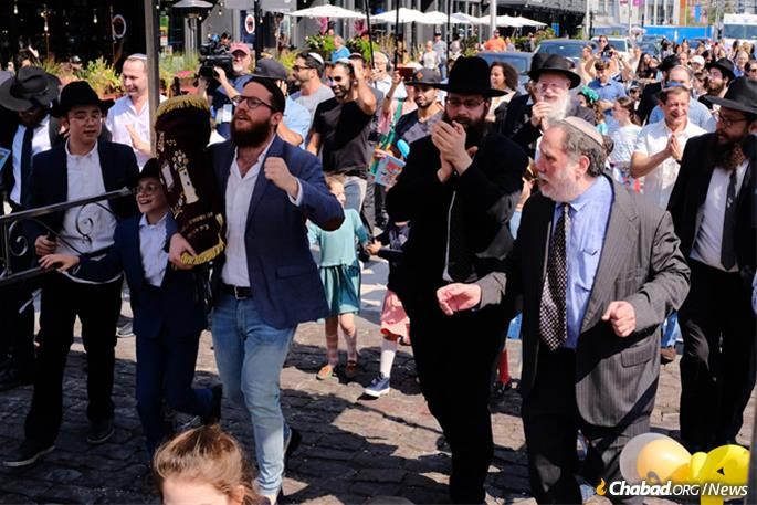 Dancing through the streets of River North with the new Torah scroll.