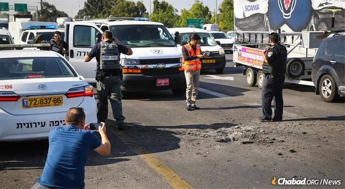 A rocket fired from Gaza hit a busy road near Gan Yavne, barely missing traffic. It was part of an ongoing barrage that targeted Israel's center and south. (Photo: Flash90)