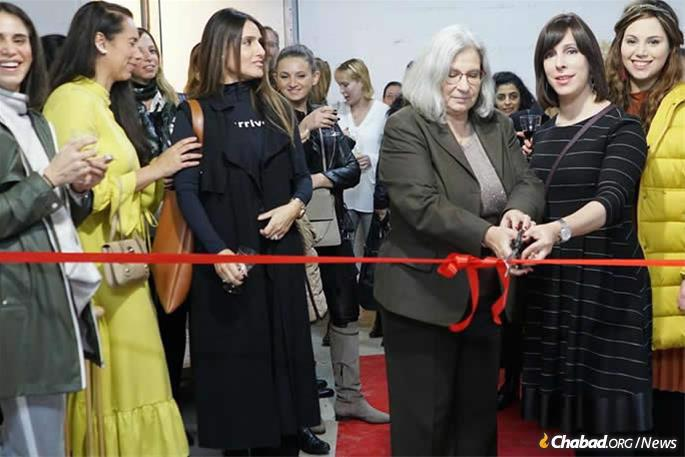 Risha Deutsch and Tamar Samash, then Israel's ambassador to Romania, cut the ribbon at the opening of Baby Chai, which lends furniture and other gear for newborns to age 3.