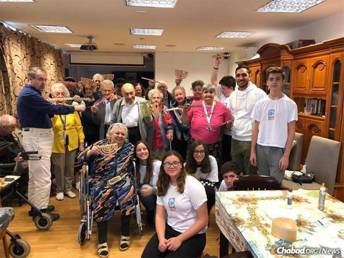 Members of Romania's CTeen chapter visit the elderly.