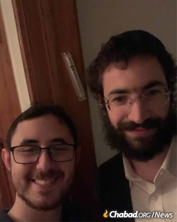 Mitch Trachtenberg and Rabbi Avremi Raichik after affixing a mezuzah
