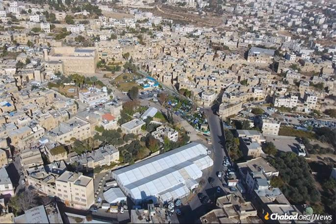 The cave, beneath in the large building upper left, is the main attraction in Hebron—one of Israel's four holy cities—housing the sunken tombs of Adam and Eve, Abraham and Sarah, Isaac and Rebecca, and Jacob and Leah. Rachel is buried on the road to Bethlehem.