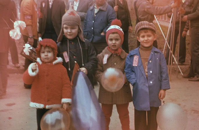 Typical picture of Soviet children at one of the Soviet parades. I am the second from the right, in a brown coat. Large military parades in Red Square, attended by top leaders of the Kremlin, especially the Politburo, became an enduring symbol of the Cold War period.