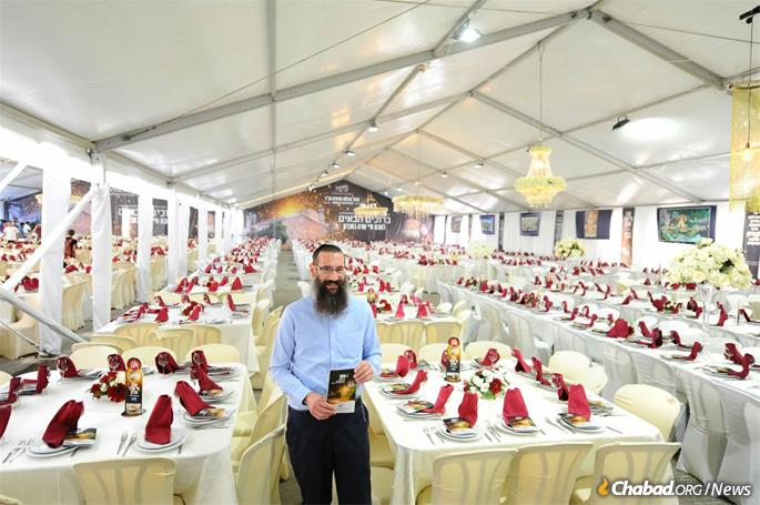 Rabbi Danny Cohen at the completion of last year's preparations for 5,000 guests. A thousand more have signed up for the meals this year.
