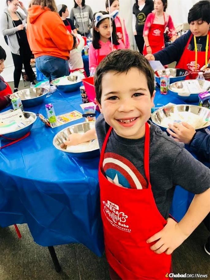 Kids learn how to bake challah and do the mitzvah of separating some dough.
