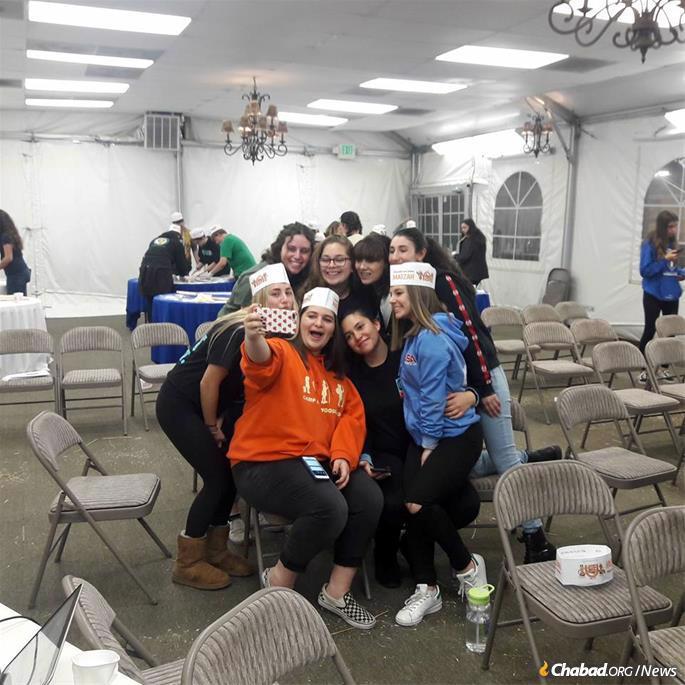 Teens have their own programs, like this matzah bake.