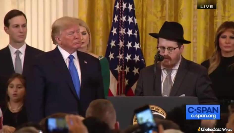 Rabbi Zvi Boyarsky, the Aleph Institute's director of constitutional advocacy, addresses a pre-Chanukah gathering at the White House on Dec. 12 as U.S. President Donald Trump, Jared Kushner, Ivanka Trump and Melania Trump look on.