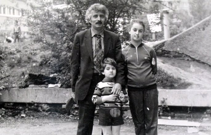 One of our last pictures from Saratov, with my father and my brother right outside of our apartment.