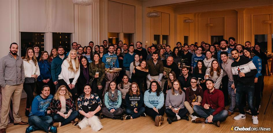 """Chabad Young Professionals of Raleigh, N.C., drew a group of 60 people to its first Chanukah celebration. This year, nearly double that number attended their """"Ambassadors of Light"""" pre-Chanukah party."""