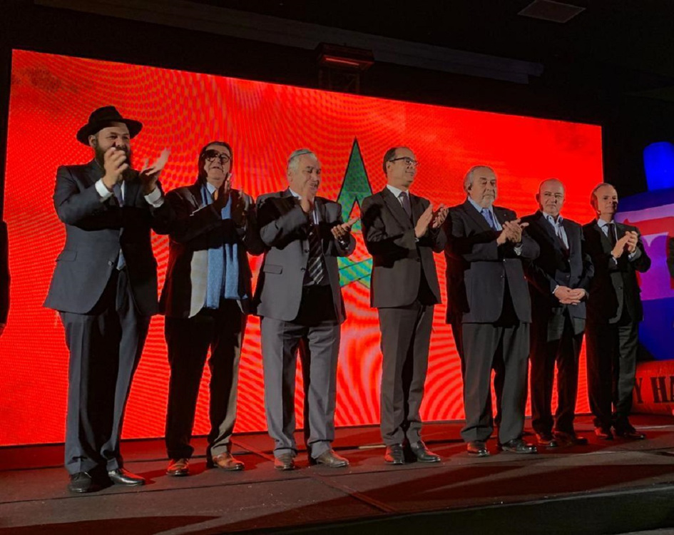 Moroccan government officials joined the Jewish community's Chanukah festivities this year. From left: Rabbi Levi Banon, director of Jeunesse Chabad of Morocco; Armand Azeroual, president of Chabad institutions in Morocco; Gabriel Ruimy, president of David Hamelech Synagogue of Casablanca; Said Ahmidouch, wali of Casablanca-Settat region; Serge Berdugo, ambassador-at-large and president of the Council of Jewish Communities; Rachid Afirat, the governor of Casablanca-Anfa prefecture; and Pierre Sibony, president of the SOC.