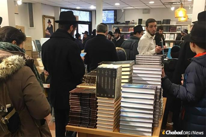 """The day has turned into the """"holiday of the books,"""" with young and old coming out, or logging on, to purchase Jewish books for their home libraries. A sampling of the crowd at Kehot Publication Society's showroom bookstore. (Photo: Kehot Publication Society)"""