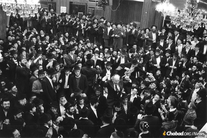 Chabad had retained well-known attorneys Nathan Lewin and Jerome Shestack to litigate the case, who were hailed in the ensuing celebrations. Lewin, a high-profile Washington, D.C.-based constitutional lawyer, can be seen being lifted onto shoulders amid dancing in the synagogue at 770 Eastern Parkway. Lewin's wife, Rikki, snapped the photo. (Photo: Nathan and Rikki Lewin)