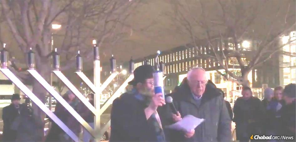 Rabbi Yossi Jacobson, who co-directs Chabad-Lubavitch of Iowa, with Vermont Sen. Bernie Sanders, who lit a large public menorah at Chabad-Lubavitch of Iowa's Chanukah celebration.