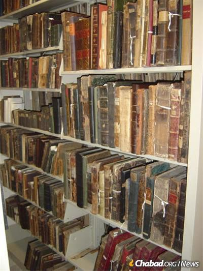 In the run-up to the court case, hundreds of rare volumes were surreptitiously removed by an individual claiming them as personal property and then sold piecemeal on the open market. A bookshelf at the library containing the reclaimed books. (Credit: Library of Agudas Chassidei Chabad)