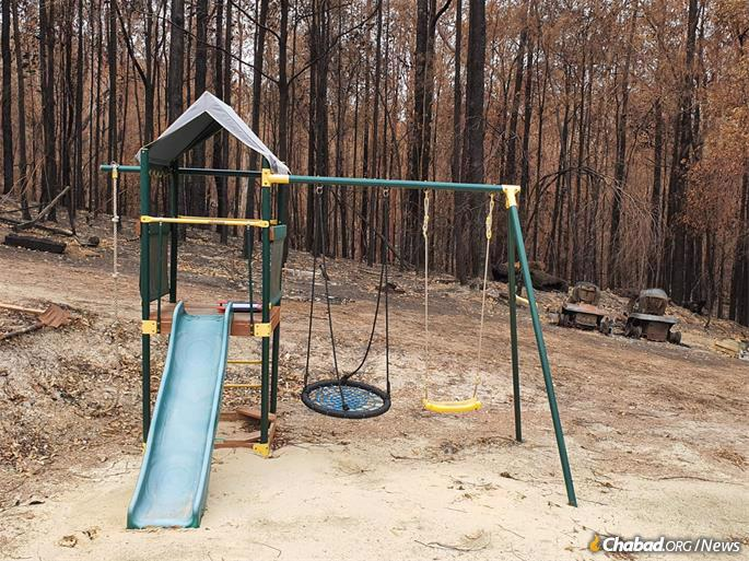 All that was left of their 25-acre property was a children's play set, which remained unscathed.