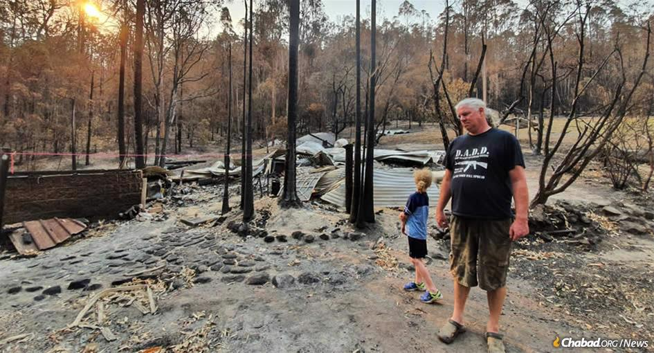 Verne Dove's huband, Troy, and her son, Jaidal, survey the destruction of their home in tiny Nana Glen (population 1,055) in New South Wales's tropical north.