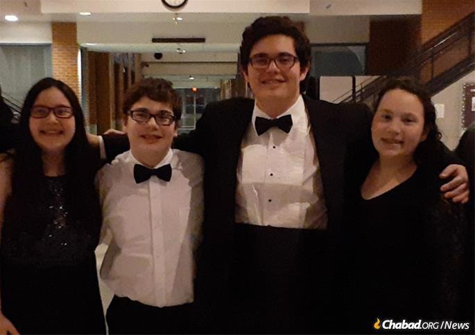 The Robbinsville, N.J., community came together to support Joel Semmel and his children—Brandon, 15, at center, and 13-year-old triplets, Ashley, Andrew and Brianna—after their wife and mother, April Semmel, suddenly passed away in August.