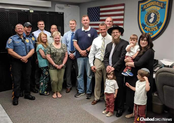 The Chaitons with members of the Robbinsville police deparatment.