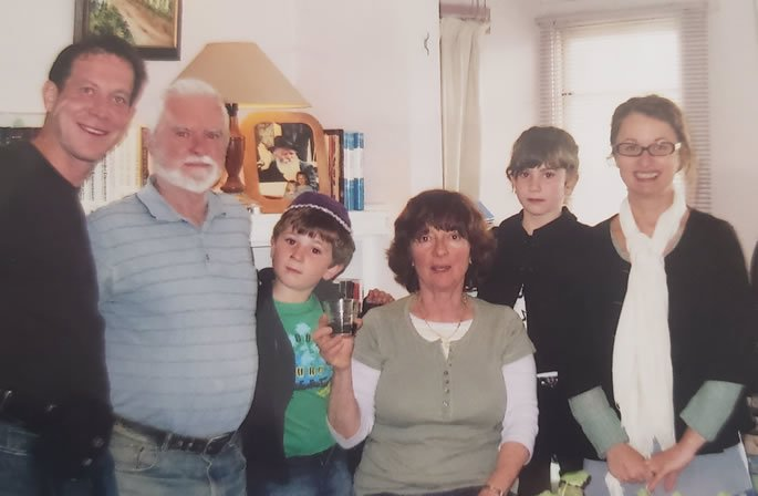 Visiting David and Penina in their home after the mikvah experience. This was the 19th of Kislev, a Chassidic holiday, and we were eating sweets and celebrating meeting each other. From left to right: Sasha Tamarkin, David, Penina, Sofya Tamarkin (and two local children).